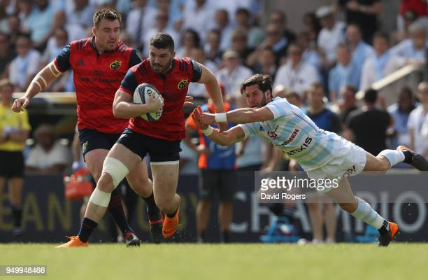 Sammy Arnold of Munster breaks away from Maxime Machenaud during the European Rugby Champions Cup SemiFinal match between Racing 92 and Munster Rugby...