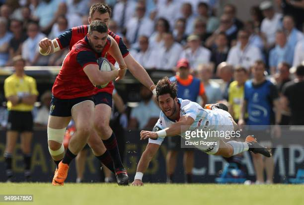 Sammy Arnold of Munster breaks away from Maxime Machenaud of Racing 92 passes the ball during the European Rugby Champions Cup SemiFinal match...