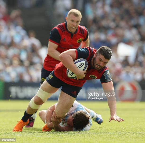 Sammy Arnold of Munster is held by Henry Chavancy during the European Rugby Champions Cup SemiFinal match between Racing 92 and Munster Rugby at...