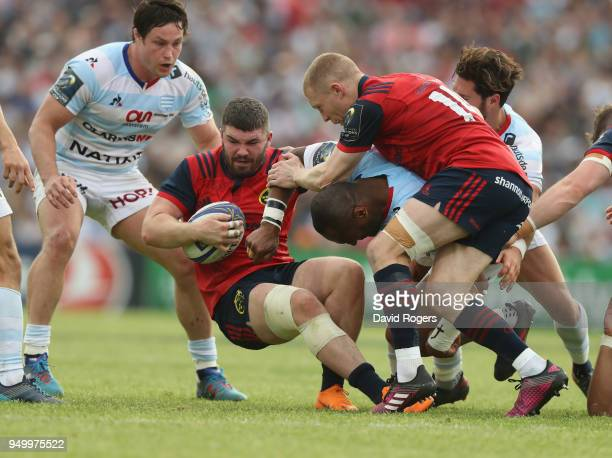 Sammy Arnold of Munster is tackled during the European Rugby Champions Cup SemiFinal match between Racing 92 and Munster Rugby at Stade ChabanDelmas...