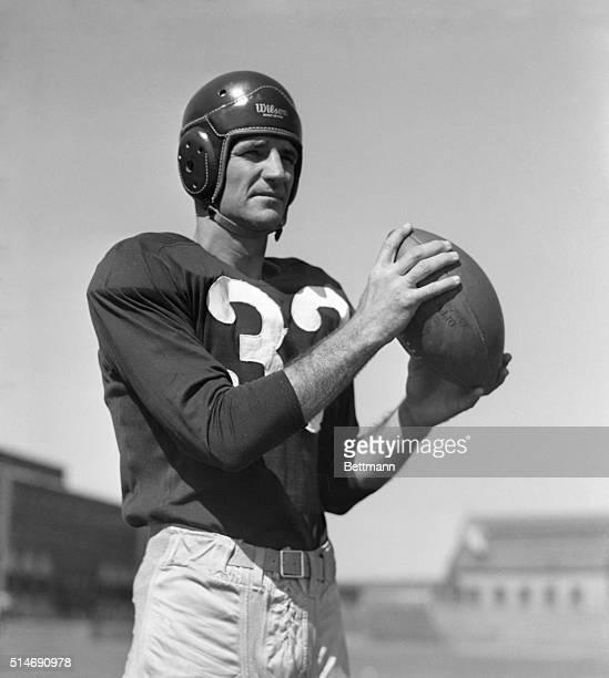 Sammy Baugh of the Washington Redskins, holding football.