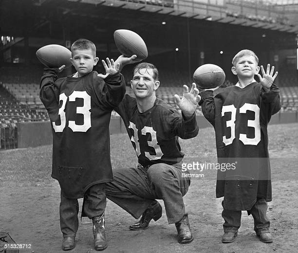 Sammy Baugh, of the Washington Redskins, one of the professional football's greatest passers for over a decade, is the father of four sons. They have...