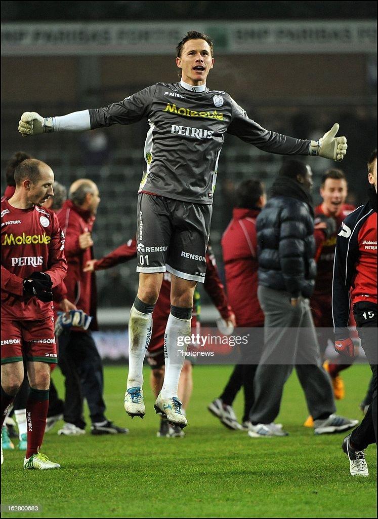 Sammy Bossut (SV Zulte Waregem) celebrates the win with teammates in action during the Jupiler League match between RSC Anderlecht and SV Zulte Waregem on February 27, 2013 in Anderlecht, Belgium.