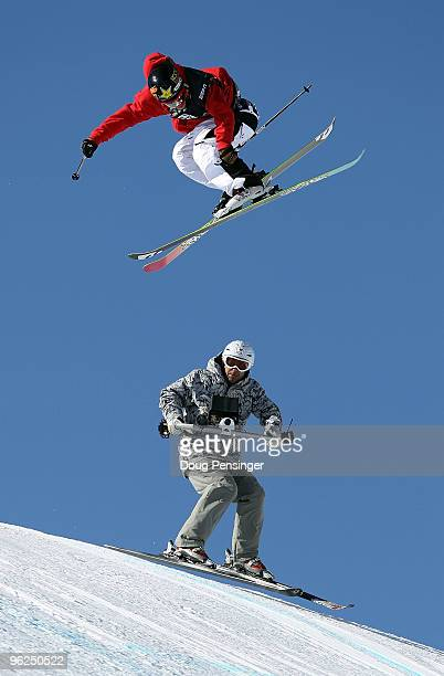 Sammy Carlson of Hood River Oregan does an aerial maneuver above the skiing television cameraman as he descends the course during the Men's Skiing...