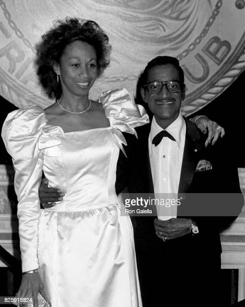 Sammy Davis Jr and Altovise Davis attend New York Friar's Club Tribute Honoring Barbara Sinatra on May 14 1988 at the Waldorf Hotel in New York City