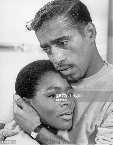 "Sammy Davis, Jr. Clutches co-star Cicely Tyson towards him during a tender scene from the film ""A Man Named Adam."" Movie Still."