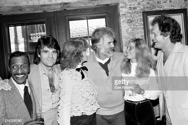 Sammy Davis Jr unknown person Dottie West Kenny Rogers Kim Carnes and Harry Chapin at manager Ken Kragens office party in Brooklyn New York on...