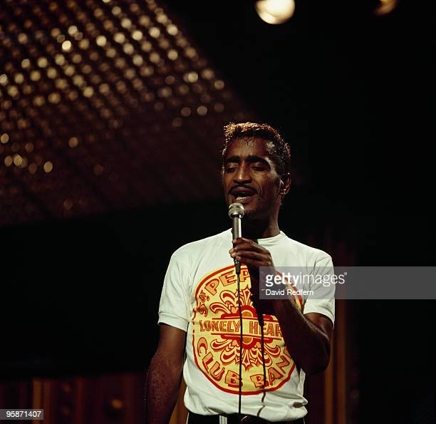 Sammy Davis Jr wearing a Beatles tshirt performs on stage at The Talk of The Town in London England in 1967