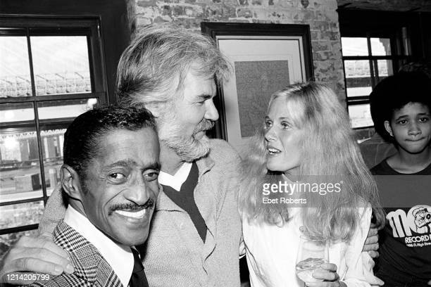 Sammy Davis Jr with Kenny Rogers and Kim Carnes at manager Ken Kragen's party in Brooklyn New York on September 26 1980