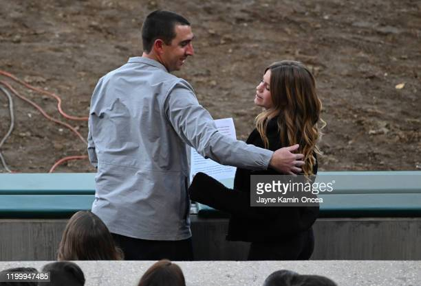 Sammy Forbath best friend of Alyssa Altobelli is embraced by JJ Altobelli during a memorial service honoring baseball coach and father John Altobelli...