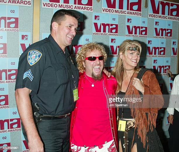 Sammy Hagar and wife Kari posing with one of New York's Finest