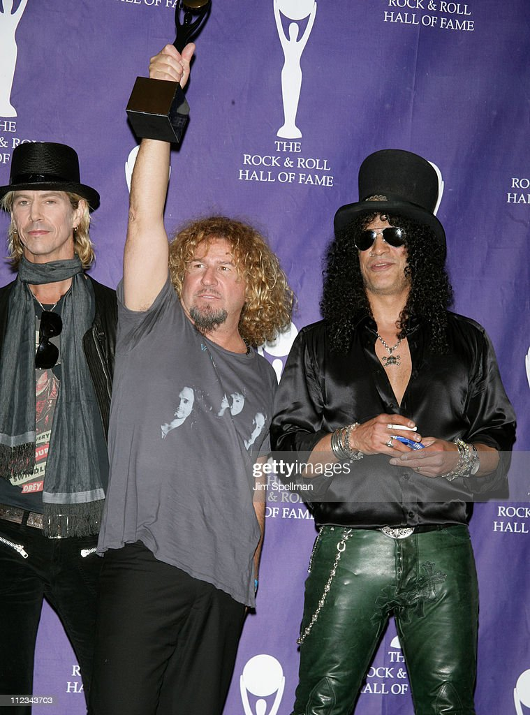 Sammy Hagar of Van Halen, inductee (center), with Duff McKagan and Slash of Velvet Revolver, presenters