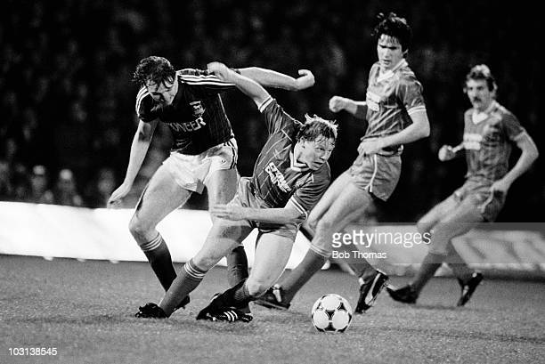 Sammy Lee of Liverpool is challenged by Ipswich Town defender Irvin Gernon as Alan Hansen and Alan Kennedy of Liverpool look on during the Football...