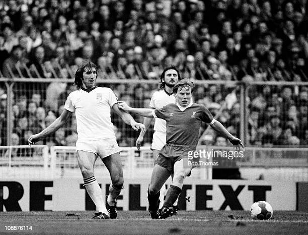 Sammy Lee of Liverpool watched by West Ham United defenders Billy Bonds and Frank Lampard during the League Cup Final at Wembley Stadium in London...