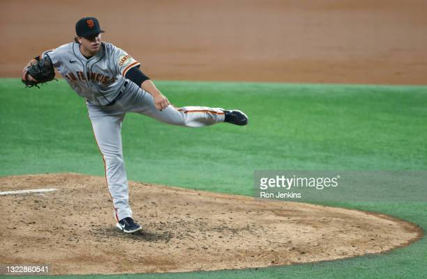 Sammy Long of the San Francisco Giants delivers against the Texas Rangers during the third inning at Globe Life Field on June 9, 2021 in Arlington,...