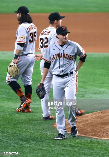 Sammy Long of the San Francisco Giants is taken out of the game against the Texas Rangers during the sixth inning at Globe Life Field on June 9, 2021...