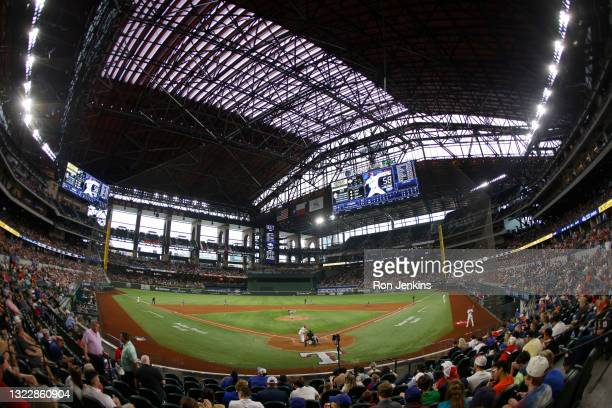 Sammy Long of the San Francisco Giants throws to Eli White of the Texas Rangers during the sixth inning at Globe Life Field on June 9, 2021 in...