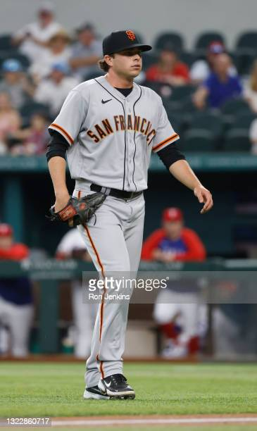 Sammy Long of the San Francisco Giants walks back to the dugout against the Texas Rangers during the second inning at Globe Life Field on June 9,...
