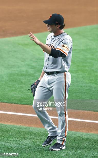 Sammy Long of the San Francisco Giants waves to fans after being taken out of the game against the Texas Rangers during the sixth inning at Globe...