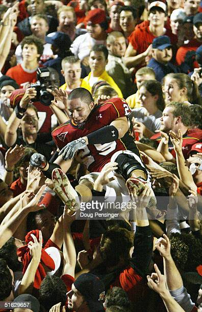 Sammy Maldonado of the Maryland Terrapins is passed above the crowd after they stormed the field after the Terrapins defeated the Florida State...
