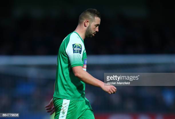 Sammy Moore of Letherhead walks off after being sent off during The Emirates FA Cup Second Round between Wycombe Wanderers and Leatherhead at Adams...