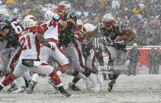 Sammy Morris of the New England Patriots gains yardage against the Arizona Cardinals at Gillette Stadium on December 21 2008 in Foxboro Massachusetts...