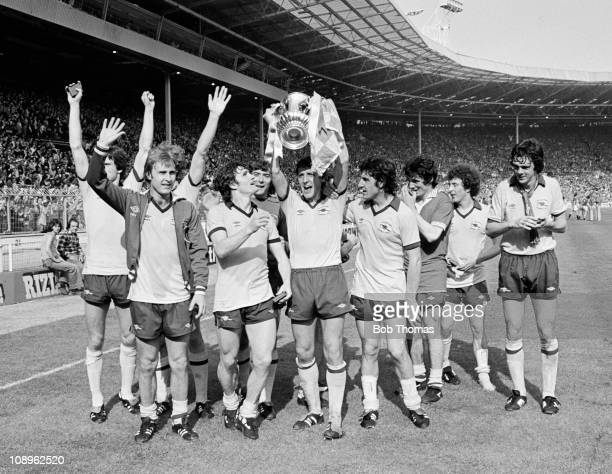Sammy Nelson of Arsenal holds the trophy aloft while celebrating with teammates after the Arsenal v Manchester United FA Cup Final held at Wembley...