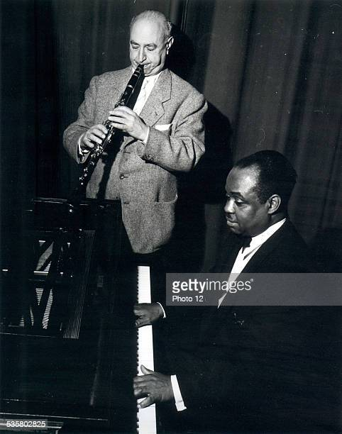 Sammy Price playing the piano and Mezz Mezzrow playing the clarinet during a jazz concert at the Salle Pleyel in Paris February 1956