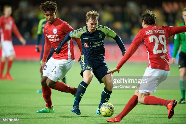 Sammy Skytte of Silkeborg IF Simon Tibbling of Brondby IF and Robert Skov of Silkeborg IF compete for the ball during the Danish Alka Superliga match...