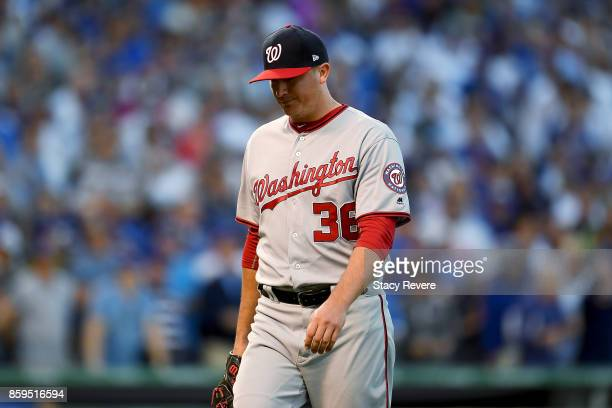 Sammy Solis of the Washington Nationals walks off the mound after being relieved in the seventh inning against the Chicago Cubs during game three of...
