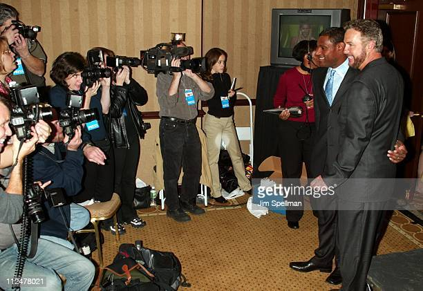 Sammy Sosa and William Petersen being photographed by the press