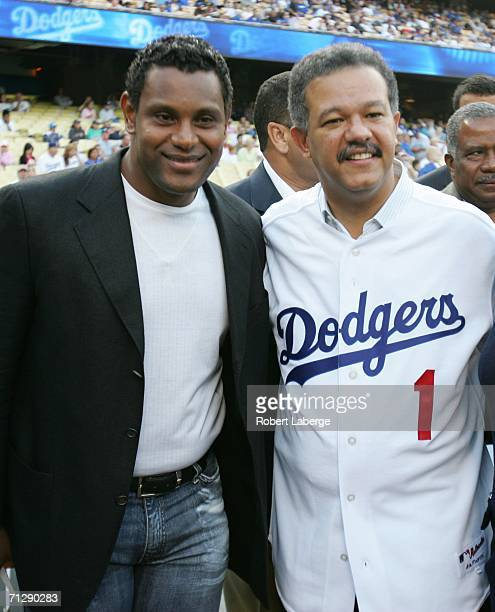Sammy Sosa appears with Dominican President Leonel Fernandez before Fernandez threw the first pitch before the game between the Los Angeles Dodgers...