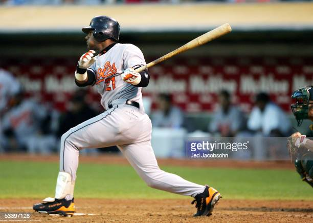 Sammy Sosa of the Baltimore Orioles follows through on an RBI single in the fourth inning against the Oakland Athletics during an MLB game at McAfee...