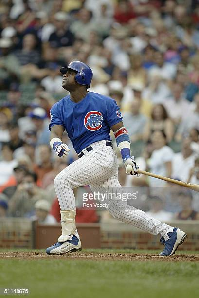 Sammy Sosa of the Chicago Cubs bats during the game against the Milwaukee Brewers at Wrigley Field on July 16 2004 in Chicago Illinois The Cubs were...