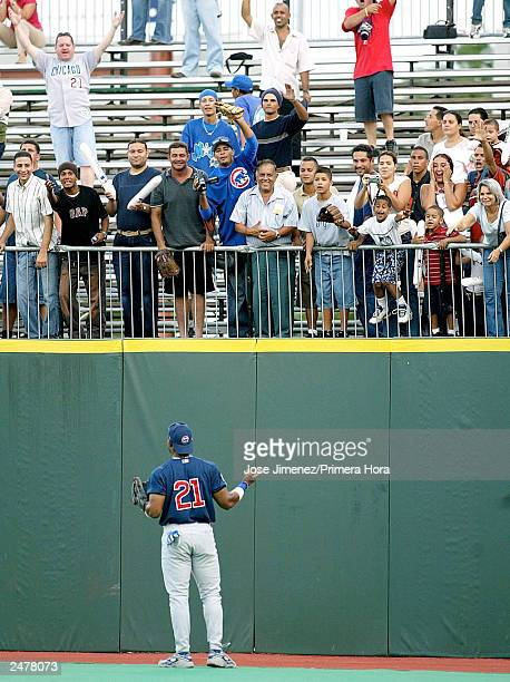 Sammy Sosa of the Chicago Cubs greets fans in the outfield bleachers prior to the Cubs' game against the Montreal Expos September 9, 2003 at Hiram...