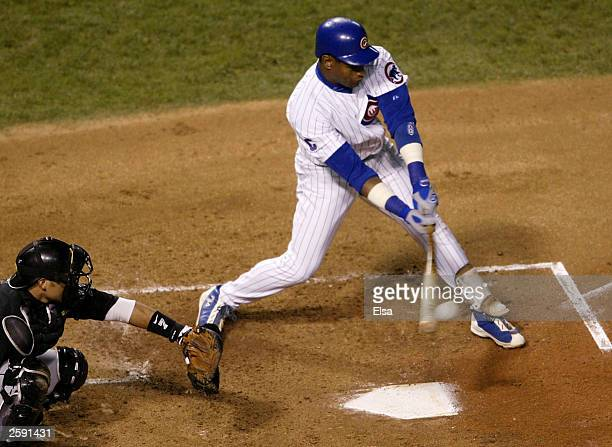Sammy Sosa of the Chicago Cubs hits a RBI double in the first inning against the Florida Marlins in Game 6 of the National League Championship Series...