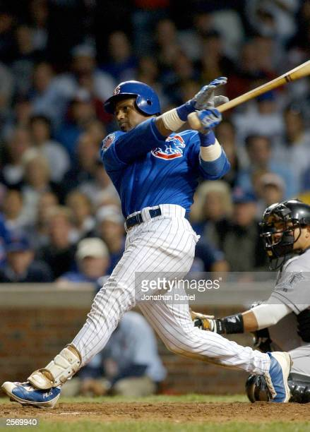 Sammy Sosa of the Chicago Cubs hits a tworun home run in the bottom of the ninth inning with two outs against the Florida Marlins during game one of...