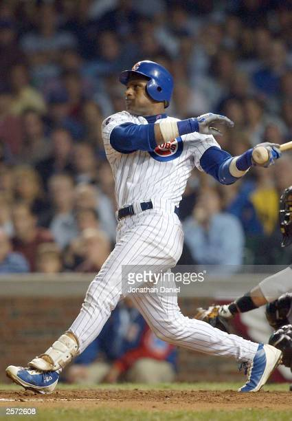 Sammy Sosa of the Chicago Cubs hits a two-run home run in the second inning against thye Florida Marlins during game two of the National League...
