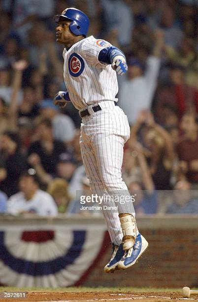 Sammy Sosa of the Chicago Cubs hits a tworun home run in the second inning against the Florida Marlins during game two of the National League...