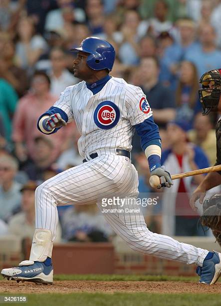 Sammy Sosa of the Chicago Cubs hits the gametying home run in the ninth inning against the Cincinnati Reds during a game on April 16 2004 at Wrigley...