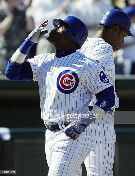 Sammy Sosa of the Chicago Cubs looks skyward after hitting a two-run homerun, his first of the spring, in the fourth inning against the Milwaukee...
