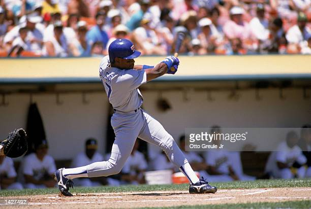 Sammy Sosa of the Texas Rangers connects with the ball during their game against the Oakland Atheletics at Oakland Stadium in Oakland California on...