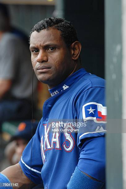Sammy Sosa of the Texas Rangers looks on from the dugout during a rain delay against the Detroit Tigers at Comerica Park in Detroit Michigan on June...