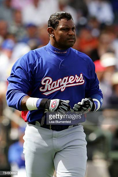 Sammy Sosa of the Texas Rangers walks back to the dugout during the game against the Kansas City Royals at Surprise Stadium on March 4 2007 in...