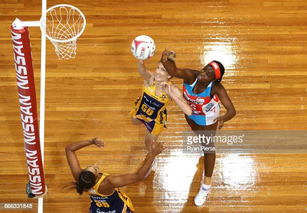 Sammy Wallace of the Swifts competes for the ball against Erena Mikaere and Geva Mentor of the Lightning during the round eight Super Netball match...