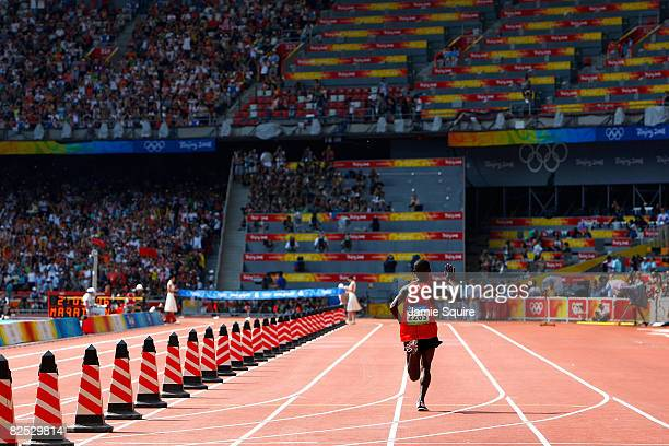 Sammy Wanjiru of Kenya waves to spectators on his way to winning the Men's Marathon in the National Stadium during Day 16 of the Beijing 2008 Olympic...