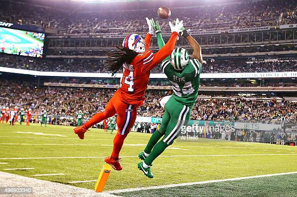Sammy Watkins of the Buffalo Bills attempts to catch a pass in the end zone under pressure from Darrelle Revis of the New York Jets during the second...