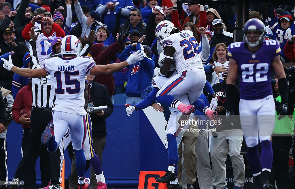 Sammy Watkins #14 of the Buffalo Bills celebrates the game tying touchdown recpetion with Anthony Dixon #26 of the Buffalo Bills and Chris Hogan #15 of the Buffalo Bills during the second half at Ralph Wilson Stadium on October 19, 2014 in Orchard Park, New York.