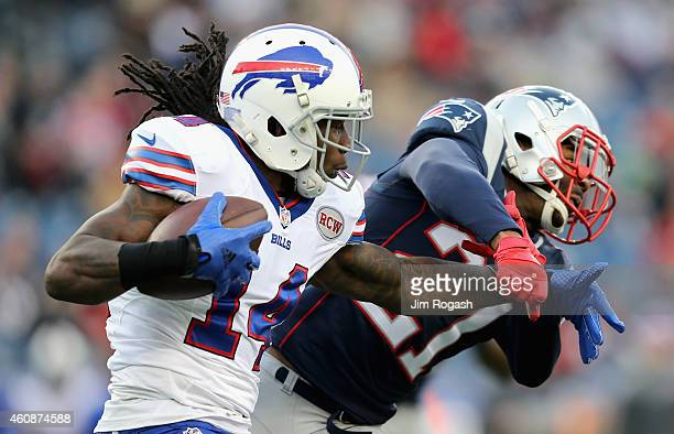 Sammy Watkins of the Buffalo Bills stiff arms Tavon Wilson of the New England Patriots during the fourth quarter at Gillette Stadium on December 28...