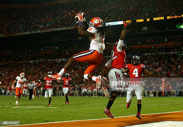Sammy Watkins of the Clemson Tigers catches a touchdown in the third quarter against Doran Grant of the Ohio State Buckeyes during the Discover...